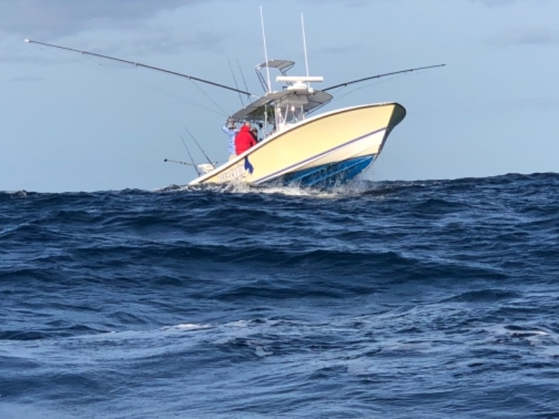 32 Contender Off The Chain trolling Stuart's Sailfish alley on a deep sea sport fishing charter.